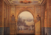 "Frons scaenae (stage wall) with trompe-l'oeil painting depicting a wall with plaster decorations and horseshoe arch opening to a ballustrade, landscape and village in the distance, Theatre Imperial Napoleon III de Fontainebleau (Fontainebleau Theatre Napoleon III), 1853-1856, by Hector Lefuel, Fontainebleau, Seine-et-Marne, France. Restoration of the theatre began in Spring 2013 thanks to an agreement between the Emirate of Abu Dhabi and the French Governement dedicating 5 M€ to the restoration.  In recognition of the sponsorship by the Emirate of Abu Dhabi, French Governement decided to rename the theatre as ""Theatre Cheikh Khalifa bin Zayed Al Nahyan"" (Cheikh Khalifa bin Zayed Al Nahyan Theatre). The achievement of the first stage of renovation has allowed the opening of the theatre to the public on May 3, 2014. Picture by Manuel Cohen"