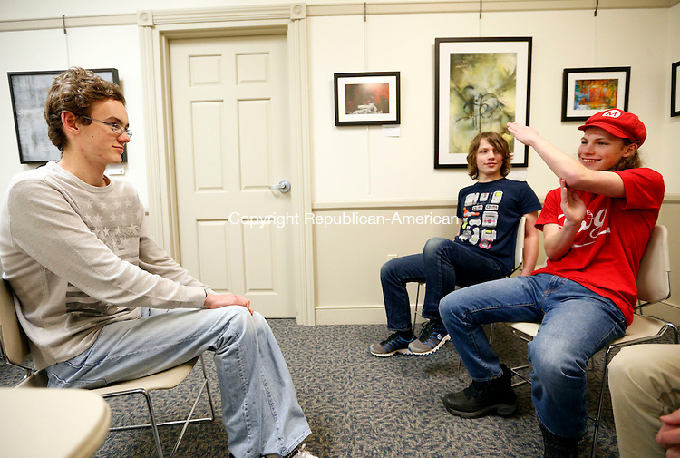 Southbury, CT- 14 January 2016-011416CM03 Justin Callanan, of Southbury, left, tries to guess what brothers  Darwin and Max Deschenes, of Southbury are portraying during an improv night at the Southbury Public Library on Thursday.  The group organized by sibling Chris & Carly Fernandes, meet the second Thursday of every month.  The event is open to anyone.  For more information contact the library at 203-262-0626.  Christopher Massa Republican-American