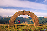 Andy Goldsworthy's Striding Arches sculptures on Bail Hill looking up Dalwhat glen to Cairnhead hill walker enjoying the view Dumfries and Galloway Scotland UK