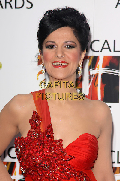 ANGELA GHEORGHIU.Attending the Classical BRIT Awards at the Royal Albert Hall in London, England, UK, May 13th, 2010..Brits arrivals portrait headshot red one shoulder strap hair up make-up lipstick dangly earrings mouth open funny .CAP/AH.©Adam Houghton/Capital Pictures.
