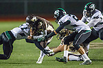 Torrance, CA 11/22/13 - Nate Kutaka (West Torrance #3), Joseph Lankford (Palmdale #21) and Jacob Mendoza (Palmdale #27) in action during the Palmdale-West Torrance CIF Northern Division quarterfinal game.  West Torrance defeated Palmdale 17-14.