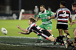 Kane Hancy sets his backline away with a dive pass from a ruck during the Air New Zealand rugby game between Counties Manukau Steelers & Manawatu, played at Mt Smart Stadium on the 22nd of September 2006. Counties Manukau 25 - Manawatu 25.