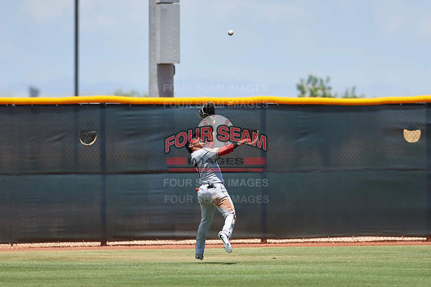 AZL Indians Red left fielder Cesar Idrogo (17) catches a fly ball during an Arizona League game against the AZL Indians Blue on July 7, 2019 at the Cleveland Indians Spring Training Complex in Goodyear, Arizona. The AZL Indians Blue defeated the AZL Indians Red 5-4. (Zachary Lucy/Four Seam Images)