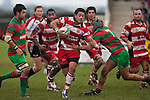 Augustine Pulu makes a run between Sam Cole & Mathew Hamilton. Counties Manukau Premier Club Rugby game between Waiuku & Karaka played at Waiuku on Saturday July 4th 2009. Waiuku won the game 22 - 7.