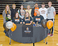 Graham Thomas/Siloam Sunday<br /> Siloam Springs senior midfielder Hailey Dorsey signed a letter of intent Wednesday to play college soccer at Hendrix College in Conway. Pictured are: From from left, mother Tammi Dorsey, Hailey Dorsey, father Ross Dorsey; back, Siloam Springs girls coach Abby Ray, grandmother Joyce Rumple, sister Madi Dorsey, grandmother Linda Dorsey, brother-in-law Cristian Monge, brother Hunter Dorsey and SSHS assistant coach Jessica Merrill.