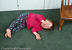 18 month old toddler girl temper tantrum lying on floor crying horizontal