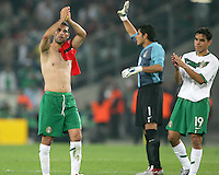 Rafael Marquez (4), goalkeeper Oswaldo Sanchez (1) and Omar Bravo (19) of Mexico say goodbye to the fans at the end of the game.Mexico and Angola played to a 0-0 tie in their FIFA World Cup Group D match at FIFA World Cup Stadium, Hanover, Germany, June 16, 2006.