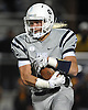 Oceanside No. 9 James Paczkowski races upfield during a Nassau County varsity football Conference I semifinal against Massapequa at Hofstra University on Saturday, Nov. 14, 2015.<br /> <br /> James Escher