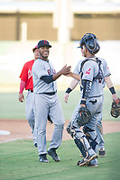 AZL Indians relief pitcher Maiker Manzanillo (22) and catcher Joshua Rolette (46) celebrate after winning a game against the AZL Angels on August 7, 2017 at Tempe Diablo Stadium in Tempe, Arizona. AZL Indians defeated the AZL Angels 5-3. (Zachary Lucy/Four Seam Images)