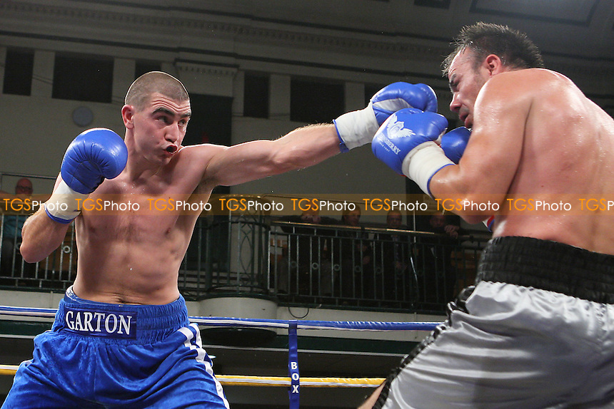 Johnny Garton (blue) shorts defeats Danny Dontchev in a Welterweight boxing contest at York Hall, Bethnal Green, promoted by Frank Warren - 21/10/11 - MANDATORY CREDIT: Gavin Ellis/TGSPHOTO - Self billing applies where appropriate - 0845 094 6026 - contact@tgsphoto.co.uk - NO UNPAID USE