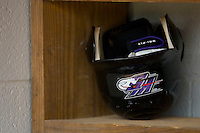 A Winston-Salem Dash batting helmet and batting gloves sit in the visitors dugout at Pfitzner Stadium June 10, 2009 in Woodbridge, Virginia. (Photo by Brian Westerholt / Four Seam Images)