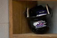 A Winston-Salem Dash batting helmet and batting gloves sit in the visitors dugout at Pfitzner Stadium June 10, 2009 in Woodbridge, Virginia. (Photo by Brian Westerholt / Four Seam Images)