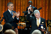 United States President Barack Obama applauds after awarding a Gershwin Prize to legendary composer and performer Burt Bacharach at a concert honoring Bacharach and fellow prize winner Hal David, in the East Room at the White House in Washington on May 9, 2012.  .Credit: Kevin Dietsch / Pool via CNP