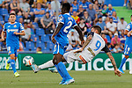 Djene Dakoman of Getafe CF and Jose Luis Mato 'Joselu' of Deportivo Alaves during La Liga match between Getafe CF and Deportivo Alaves at Colisseum Alfonso Perez in Getafe, Spain. August 31, 2019. (ALTERPHOTOS/A. Perez Meca)
