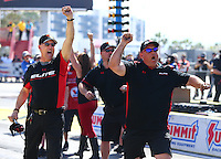 Apr 12, 2015; Las Vegas, NV, USA; Crew members celebrate after NHRA pro stock driver Erica Enders-Stevens wins the Summitracing.com Nationals at The Strip at Las Vegas Motor Speedway. Mandatory Credit: Mark J. Rebilas-