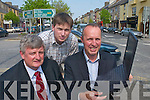 PLANS: The three wise men from the Castleisland bypass committee look at plans for the new bypass around Castleisland, which was announced last week. L-r: Michael McElligott, Cormac OMahony and Jeremy Burke..
