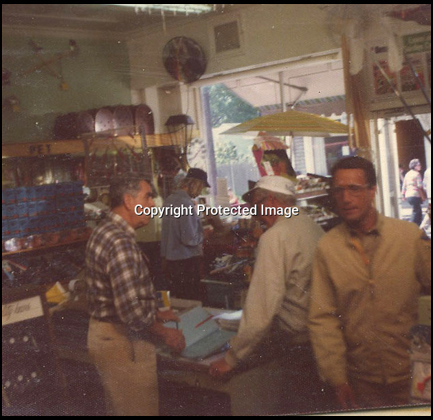 BNPS.co.uk (01202 558833)<br /> Pic: NateDSaunders/BNPS<br /> <br /> ***Please use full byline***<br /> <br /> Roy Scheider (right) who played Chief Brody. Shot taken in a hardware shop in a break during filming. <br /> <br /> Rare behind-the-scenes photographs taken on the set of the cult movie 'Jaws' has surfaced after 40 years.<br /> <br /> The 75 pictures include ones of star Roy Scheider, who played shark-hunting police chief Brody in the classic 1975 film, and director Steven Spielberg.<br /> <br /> There are several snaps of the giant mechanical rubber shark that wreaked terror on the fictional seaside resort of Amity.<br /> <br /> It is depicted being hoisted in the air and moved into position as well as sat in a dry dock during a break in the filming.