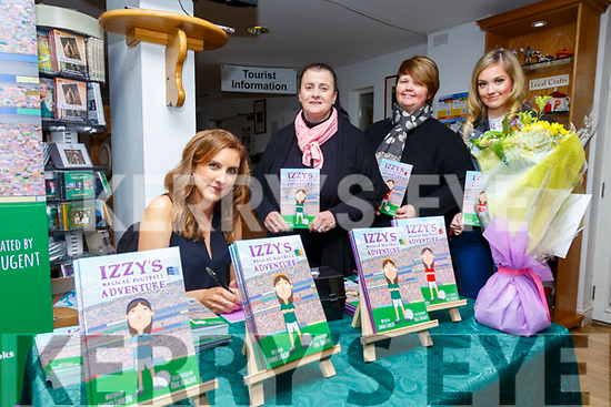 """Book Launch: Emma Larkin, Listowel signing copies  of her book """"Izzy's Magical Football Adventure"""" at Kerry Writers Museum, Listowel on Friday nigh last. Also in picture are Christine McKenna & Mags & Emma Foley."""