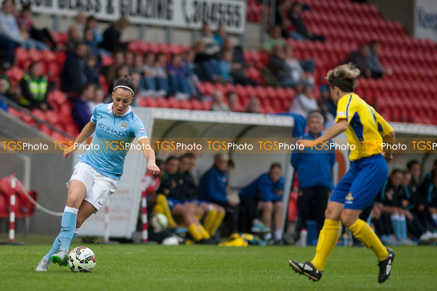 Lucy Bronze (Man City Women) and Sue Smith (Doncaster Belles)<br /> Doncaster Rovers Belles vs Manchester City Women, FA Womens Super League Continental Tyres Cup Football at the Keepmoat Stadium, Stadium Way, Doncaster, West Riding of Yorkshire on 23/07/2015 - MANDATORY CREDIT: Mark Hodsman/TGSPHOTO
