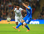 Raheem Sterling of England passes Valter Birsa of Slovenia - England vs. Slovenia - UEFA Euro 2016 Qualifying - Wembley Stadium - London - 15/11/2014 Pic Philip Oldham/Sportimage