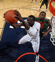 CHARLOTTESVILLE, VA- JANUARY 7:  Assane Sene #5 of the Virginia Cavaliers grabs a rebound in front of Reggie Johnson #42 of the Miami Hurricanes during the game on January 7, 2012 at the John Paul Jones Arena in Charlottesville, Virginia. Virginia defeated Miami 52-51. (Photo by Andrew Shurtleff/Getty Images) *** Local Caption *** /v533/;Reggie Johnson