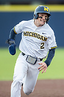 Michigan Wolverines shortstop Jack Blomgren (2) runs to third base against the Western Michigan Broncos on March 18, 2019 in the NCAA baseball game at Ray Fisher Stadium in Ann Arbor, Michigan. Michigan defeated Western Michigan 12-5. (Andrew Woolley/Four Seam Images)