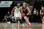 25 February 2016: Wake Forest's Milan Quinn (32) steals the ball from Virginia Tech's Regan Magarity (SWE). The Wake Forest University Demon Deacons hosted the Virginia Tech Hokies at Lawrence Joel Veterans Memorial Coliseum in Winston-Salem, North Carolina in a 2015-16 NCAA Division I Women's Basketball game. Virginia Tech won the game 54-48.