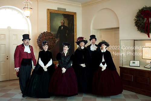 Washington, DC - December 20, 2009 -- The Dickens Carolers greet guests in the Book Cellars Hall of the White House during a holiday party, Sunday, December 20, 2009. .Mandatory Credit: Chuck Kennedy - White House via CNP
