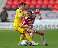 Fleetwood Town's Ross Wallace battles with Doncaster Rovers' Herbie Kane<br /> <br /> Photographer David Shipman/CameraSport<br /> <br /> The EFL Sky Bet League One - Doncaster Rovers v Fleetwood Town - Saturday 6th October 2018 - Keepmoat Stadium - Doncaster<br /> <br /> World Copyright &copy; 2018 CameraSport. All rights reserved. 43 Linden Ave. Countesthorpe. Leicester. England. LE8 5PG - Tel: +44 (0) 116 277 4147 - admin@camerasport.com - www.camerasport.com