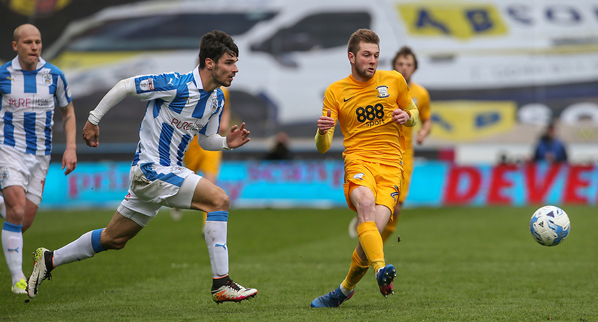 Preston North End's Tom Barkhuizen gets away from Huddersfield Town's Christopher Schindler<br /> <br /> Photographer Alex Dodd/CameraSport<br /> <br /> The EFL Sky Bet Championship - Huddersfield Town v Preston North End - Friday 14th April 2016 - The John Smith's Stadium - Huddersfield<br /> <br /> World Copyright &copy; 2017 CameraSport. All rights reserved. 43 Linden Ave. Countesthorpe. Leicester. England. LE8 5PG - Tel: +44 (0) 116 277 4147 - admin@camerasport.com - www.camerasport.com