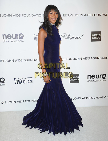 Naomi Campbell.The 21st Annual Elton John AIDS Foundation Academy Awards Viewing Party held at The City of West Hollywood Park in West Hollywood, California, USA..February 24th, 2013.oscars full length black midnight navy blue dress sleeveless side diamond bracelets .CAP/DVS.©DVS/Capital Pictures.