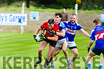 Mark Buckley Tarbert closely marked by Tadhg McEllistrem Ballylongford watched by Kenneth Foley Ballylongford during the North Kerry Championship game in Ballylongford on Sunday.