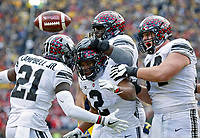 Ohio State Buckeyes running back J.K. Dobbins (2) celebrates his touchdown run with Ohio State Buckeyes wide receiver Parris Campbell (21) and Ohio State Buckeyes offensive lineman Billy Price (54) against Michigan Wolverines during a run during the 2nd half of their game at Michigan Stadium on November 25, 2017.  [Kyle Robertson\ Dispatch]