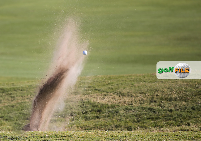 16 OCT 13 A ghost ball appears from the front bunker on 18 during Thursdays First Round of The Shriners Childrens Hospitals Open at The TPC at Summerlin in Las Vegas, Nevada.  (photo:  kenneth e.dennis / kendennisphoto.com) Picture: Ken Dennis www.golffile.ie
