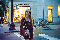Hordes of shoppers in Greenwich Village in New York on Thursday, September 6, 2012 during the fourth annual Fashion's Night Out event. On the first evening of New York Fashion Week stores around the city offer sales and bargains as well as parties and events to entice customers to shop. The event has been so successful in boosting sales that over 100 cities in the US are having their own events, and Fashion's Night Out events occur in fashion-forward cities around the world. (© Frances M. Roberts)