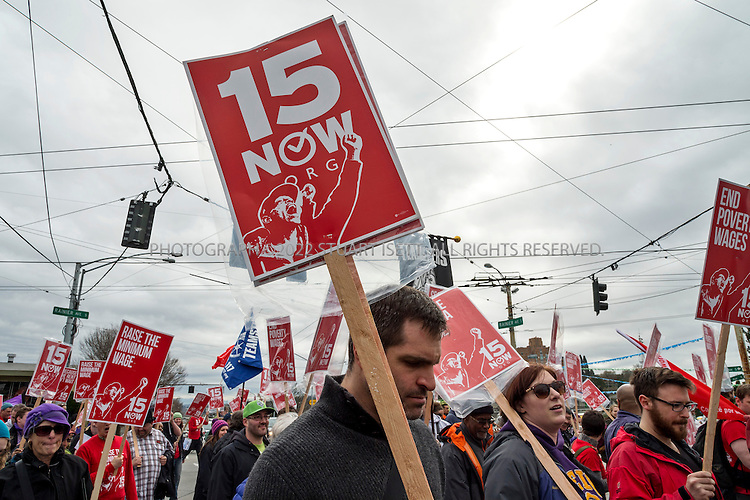 3/16/2014&mdash;Seattle, WA, USA<br /> <br /> A Seattle group started to push for a raise in the minimum wage called &ldquo;$15 Now!&rdquo; held a march  to raise to demand the city council the minimum wage to $15 per hour. Several hundred people marched from Judkins Park in the city&rsquo;s Central District  to Seattle Central Community College on Capitol Hill where a rally was held. Social city council member Kshama Sawant spoke at the rally.<br /> <br /> <br /> Photograph by Stuart Isett<br /> &copy;2014 Stuart Isett. All rights reserved.