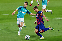 16th July 2020; Camp Nou, Barcelona, Catalonia, Spain; La Liga Football, Barcelona versus Osasuna;  Leo messi manages to make space against Nacho Vidal and cross to a team mate