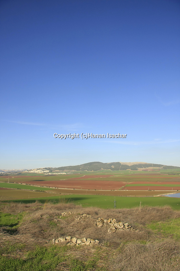 Israel, Tel Jezreel at the foothill of Mount Gilboa overlooking Jezreel valley, Givat Hamore is in the background