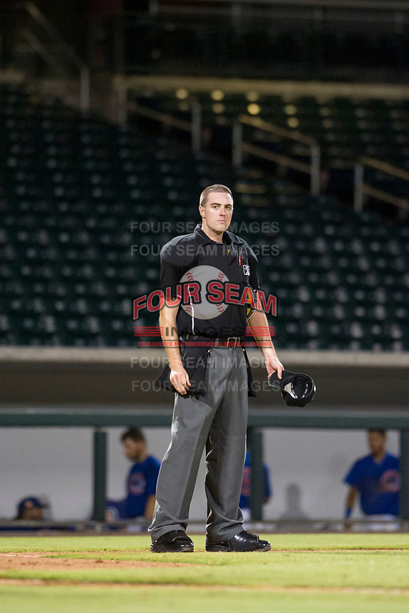 MiLB home plate umpire Andrew Clark handles the calls behind the plate during the game between the AZL Diamondbacks and AZL Cubs on August 11, 2017 at Sloan Park in Mesa, Arizona. AZL Cubs defeated the AZL Diamondbacks 7-3. (Zachary Lucy/Four Seam Images)