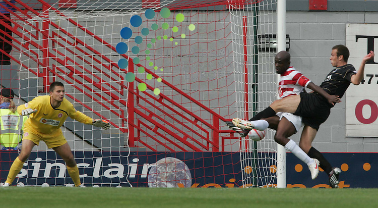 Andrew Considine scores the second goal for Aberdeen past keeper Tomas Cerny during the Clydesdale Bank Scottish Premier League Hamilton v Aberdeen FC at New Douglas Park Hamilton..22 August 2009. Picture: Maurice McDonald/ Universal News And Sport.................... ........... .