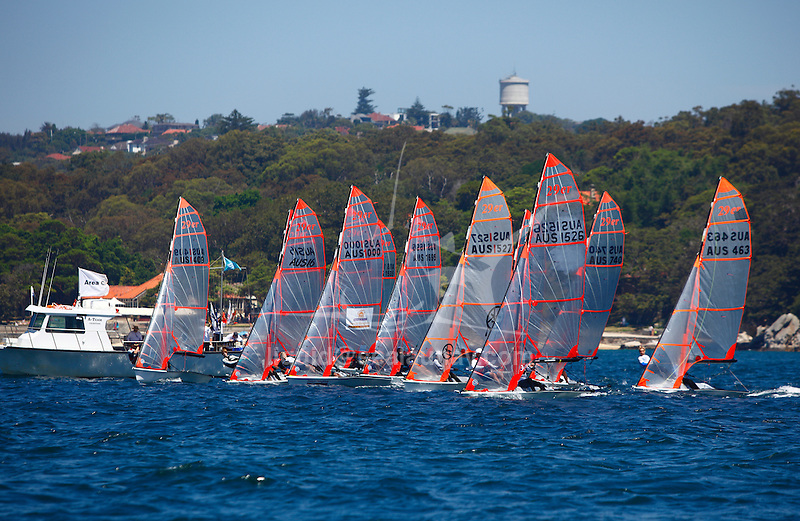 Day 3 of the Sail Sydney 2009 regatta, 29ers..Held annually Sail Sydney take place from the 5-8 December 2009 on the magnificent Sydney Harbour as part of the Sail Down Under series, incorporating Sail Brisbane, Sail Sydney and Sail Melbourne..Competitors from around the world bring Sydney Harbour to life as athletes look to establish themselves on the sailing scene in the lead up to the London Olympics in 2012..The four day regatta incorporate Olympic, International and Youth classes on the three Sydney Harbour courses used by the 2000 Sydney Olympics. Spectacular action from the 49er and International Moth classes can be expected along with the Laser, Laser Radial, Finn, RS:X and 470s as they campaign towards 2012..Over 400 participate and sail out of host venue: Woollahra Sailing Club in Rose Bay.