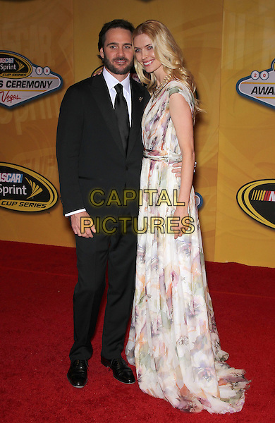 JIMMY & CHANDRA JOHNSON .NASCAR Sprint Cup Series Awards Ceremony at the Wynn Las Vegas, Nevada, USA, 3rd November 2010..full length black suit tie white print long maxi dress .CAP/ADM/MJT.© MJT/AdMedia/Capital Pictures.