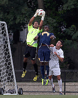 Boston College goalkeeper Justin Luthy (1) and Quinnipiac University forward Machel Baker (8) battle for the ball. Boston College defeated Quinnipiac, 5-0, at Newton Soccer Field, September 1, 2011.