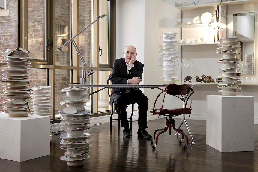Murray Moss at his new space in the garment district. Surrounding his desk is a piece by Johaness Nagel called Improvisation/Free Jazz, which will be offered at the upcoming auction at Phillps de Pury, Moss: Dialogues Between Art and Design...Danny Ghitis for The New York Times