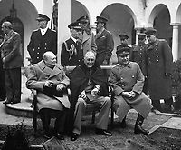 "Conference of the Big Three at Yalta makes final plans for the defeat of Germany.  Here the ""Big Three"" sit on the patio together, Prime Minister Winston S. Churchill, President Franklin D. Roosevelt, and Premier Josef Stalin.  February 1945. (Army)<br /> Exact Date Shot Unknown<br /> NARA FILE #:  111-SC-260486<br /> WAR & CONFLICT BOOK #:  750"