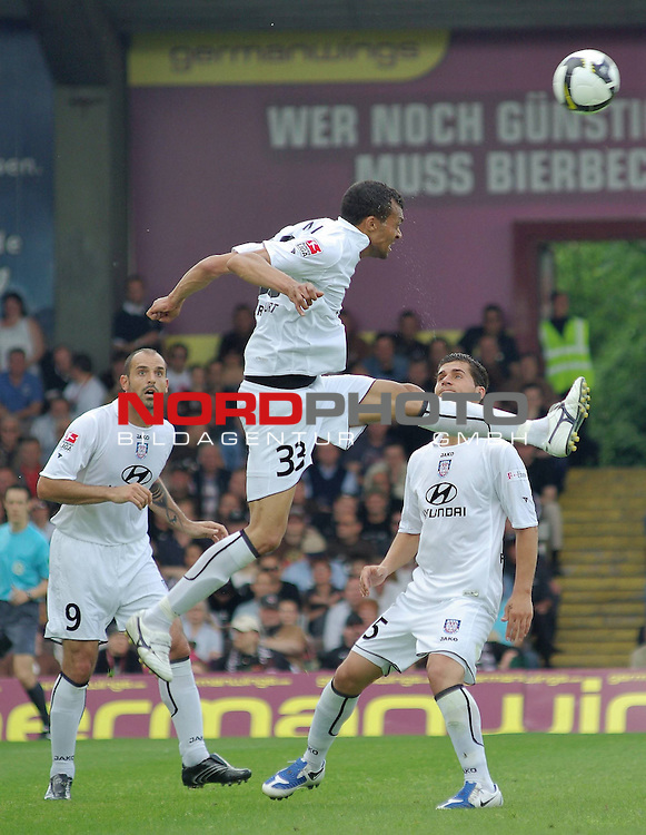 2. FBL  2008/2009 34. Spieltag R&uuml;ckrunde<br /> <br /> FC St. Pauli - FSV Frankfurt<br /> <br /> Matias Esteban Cenci (#9, Frankfurt), Emil Noll (#33, Frankfurt), Dennis Hillebrand (#5, Frankfurt)<br /> <br /> <br /> Foto &copy; nph (  nordphoto  )