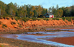 Images of The Canadian Maritime Provinces of Nova Scotia and Prince Edward Island.  Red cliffs of Prince Edward Island with a  red house.
