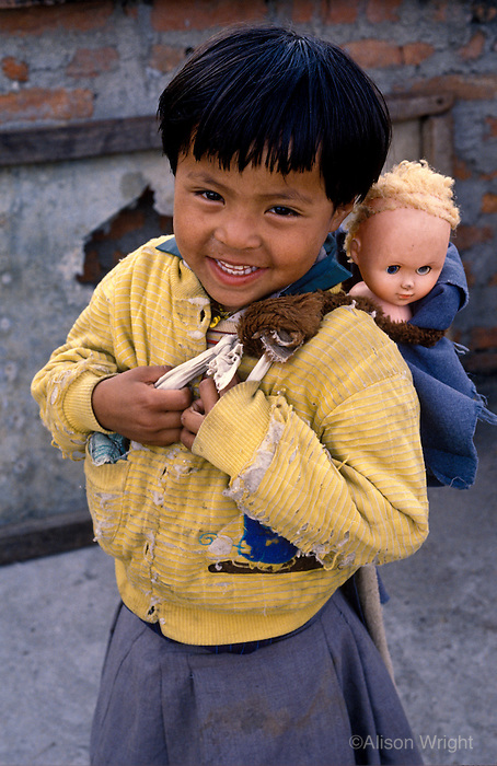 Nepal, Kathmnadu. Domze, Tibetan refugee girl gets her first doll.