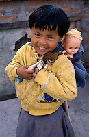 Nepal, Kathmnadu. Domze, Tibetan refugee girl gets her first doll.