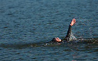 16 MAY 2010 - LYDD, GBR - A competitor swims backstroke during The Marshman Triathlons (PHOTO (C) NIGEL FARROW)